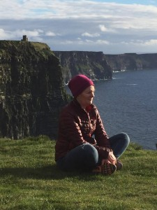 tricia mc donnell of doolin yoga centre sits out looking over the wild atlantic way