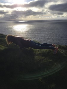 tricia mc donnell works out while looking out over the atlantic way - doolin yoga centre